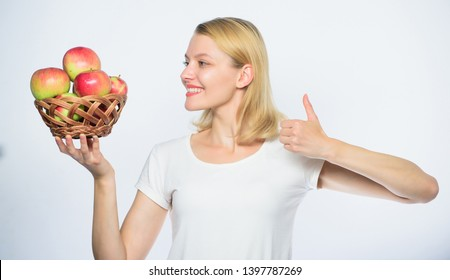 Detox diet. farming concept. thumb up. healthy teeth. Happy woman eating apple. orchard, gardener girl with apple basket. autumn harvest. Spring seasonal fruit. vitamin and dieting food.