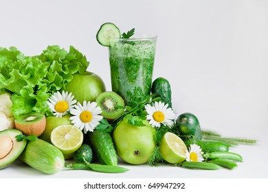 Detox diet, fitness concept of healthy eating. Fresh green smoothie with green vegetables and fruits isolated on white background. Selective focus.