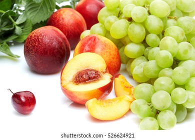 Detox diet food and drink & healthy lifestyle concept Colorful fruits & herbs. Grapes cherry peach & mint. Front view. Isolated on white.