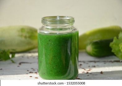 Detox diet. Green smoothie with different vegetables on white wooden background copy space. diet vegitarians healthy low calorie food. salad, greens, green apple chia or flax linen seeds