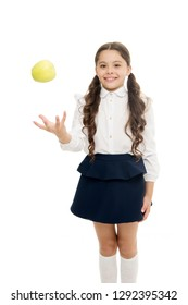 Detox and diet. Healthy nutrition diet. Girl pupil hold apple fruit on white background. Kid happy hold apple. School snack concept. Apple vitamin snack. Schoolgirl wear formal uniform hold apple.