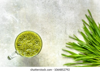 Detox drink with green barley grass, healthy organic smoothie in jar, overhead