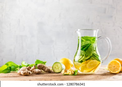 Detox drink made of ginger, cucumber, lemon cold served in glasses and decanters