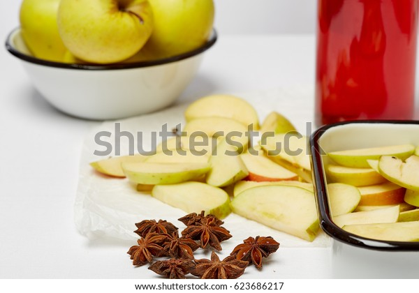 Detox food & drink healthy diet vegetarian lifestyle concept: Fresh fruit and fruit drinks. Apple, Sliced apples, cherry juice & spices. Closeup Top view White background