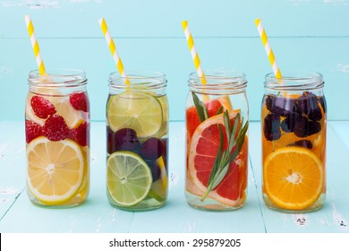 Detox fruit infused flavored water. Refreshing summer homemade cocktail