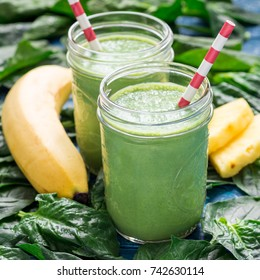 Detox green smoothie with spinach, pineapple, banana and yogurt, square format