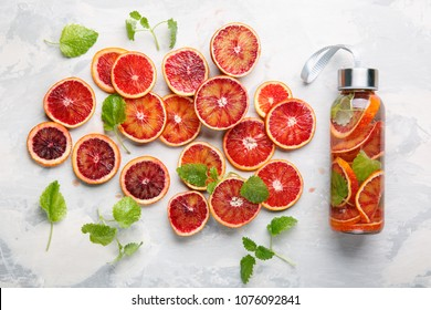 Detox infused water flavored with bloody orange and mint. Healthy refreshing beverage.  Top view.