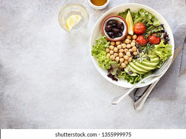 Detox salad with chick pea, avocado, grilled tomatoes and olives. Healthy salad bowl for super food, clean eating, plant based diet concepts.