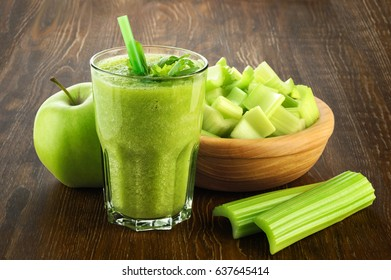 Detox smoothie with celery and apple on a wooden background. Healthy food.