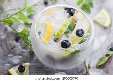 Detox water cocktail,blueberry ,lime, lemon and ice.selective focus