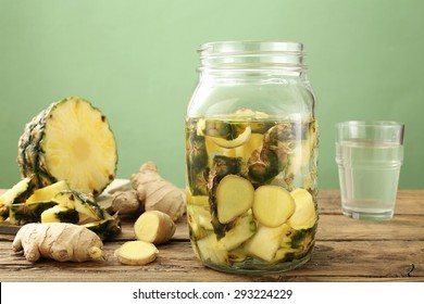 detox water ginger and pineapple rustic background