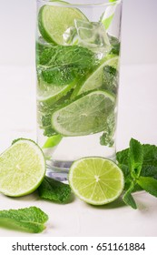 Detox water with lime and mint in glass. Mojito cocktail. on a white background