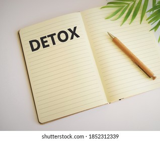 Detox word written in notebook.Healthcare concept. Digital detox as disconnected internet life style concept.Free space for text. Copy space. Top view.