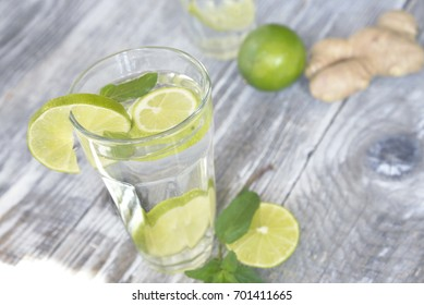 detox your body with a glass of water with lime, mint and ginger