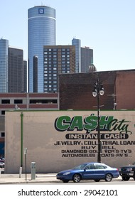 DETROIT - April 11, 2009 - A Pawn shop sign on the side of a building in downtown Detroit with the financaily ailing  General Motors headquarters in background. GM is facing possible bankruptcy.