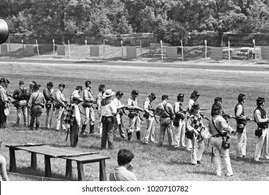 DETROIT – AUGUST 10, 1979: people shooting in a Dearborn public park. Vintage picture taken in 1979.