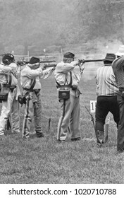 DETROIT – AUGUST 10, 1979: people shooting in a Dearborn public park. Vintage picture taken in 1979.