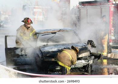 Detroit Firemen putting out a car fire