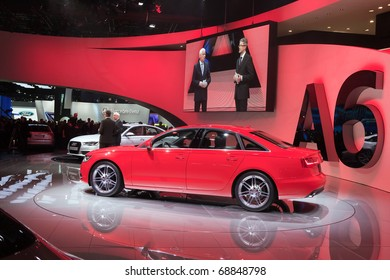 DETROIT - JANUARY 10: Audi Executives show off the new hybrid A6 at the 2011 North American International Auto Show Press Preview on January 10, 2011 in Detroit, Michigan.