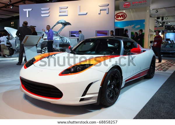 DETROIT - JANUARY 10: Tesla Roadster electric sports car on display at the 2011 North American International Auto Show Press Preview on January 10, 2011 in Detroit, Michigan.
