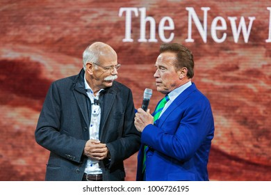 DETROIT - JANUARY 14 : Arnold Schwarzenegger talks with Mercedes President Dieter Zetsche at the NAIAS media preview January 14, 2018 in Detroit, MIchigan.