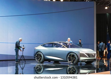 DETROIT - JANUARY 15: Members of the media loking at a Nissan Prototype on display at the North American International Auto Show media preview January 15, 2019 in Detroit, Michigan.