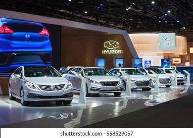 DETROIT - JANUARY 9: A row of Hyundai sedans on display at the North American International Auto Show media preview January 9, 2017 in Detroit, Michigan.