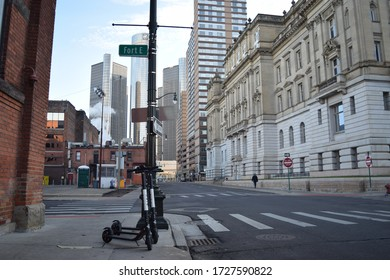 Detroit, MI - December 2019: Wayne County building with the Renaissance Center in the background. Downtown Detroit street view.