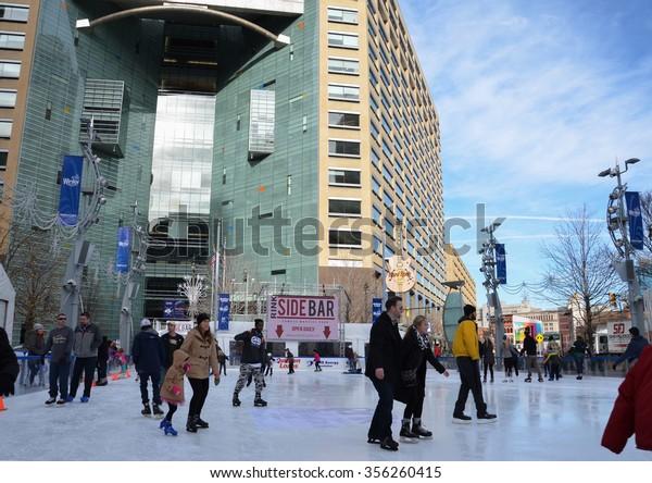 DETROIT, MI - DECEMBER 24: People skate in the rink at Campus Martius park in downtown Detroit, MI, on December 24, 2015.