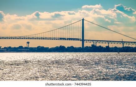 Detroit, MI, USA - 2 October 2016: The Ambassador Bridge spans the Detroit River connecting Detroit with Windsor, Ontario, Canada.