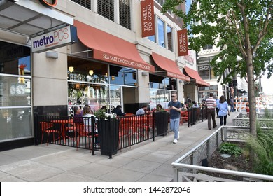 DETROIT, MI / USA - JUNE 30, 2019:  People walking by the Avalon restaurant in downtown Detroit.