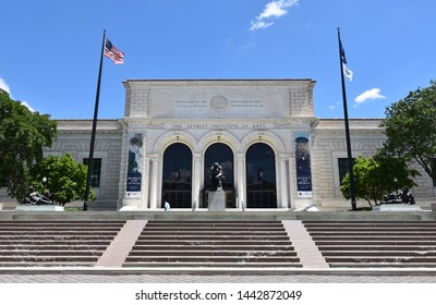 DETROIT, MI / USA - JUNE 30, 2019:  Visitor walks by entrance to the Detroit Institute of Arts