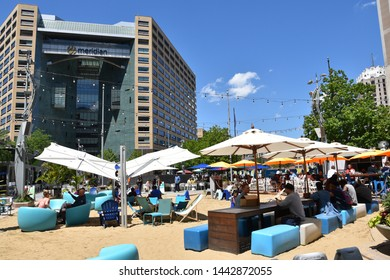 DETROIT, MI / USA - JUNE 30, 2019:  People enjoying a sunny day in Campus Martius park.