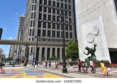 DETROIT, MI / USA - JUNE 30, 2019:  Visitors walk past the Spirit of Detroit statue in downtown Detroit.