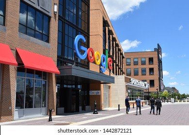 DETROIT, MI / USA - JUNE 30, 2019:  People walk past the new Google offices next to the Little Caesars arena.