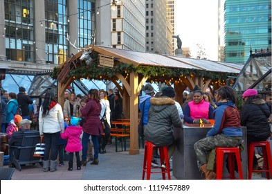 DETROIT, MI / USA - NOVEMBER 24, 2017:  Visitors relax at the Cadillac Square Marketplace in downtown Detroit.