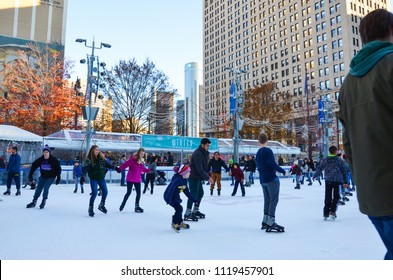 DETROIT, MI / USA - NOVEMBER 24, 2017: People skate in the rink at Campus Martius park in downtown Detroit.