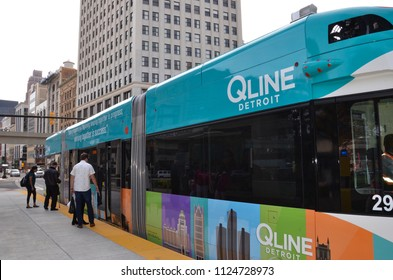 DETROIT, MI / USA - OCTOBER 21, 2017:  Riders board Detroit's QLine, which runs along Woodward Avenue in downtown Detroit.