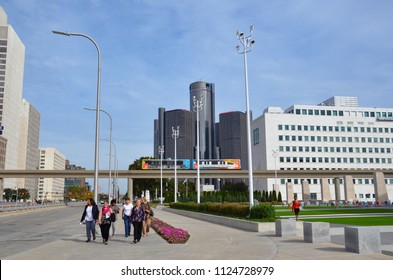 DETROIT, MI / USA - OCTOBER 21, 2017:  Women walk along Jefferson Avenue near Cobo Hall in downtown Detroit, with the Renaissance Center in the background.