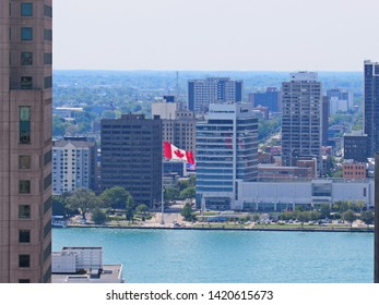 Detroit, MI/6/8/19: In downtown Windsor, Ont., seen from across the Detroit River, the maple leaf flag flies in front of the Chrysler Canada office building.
