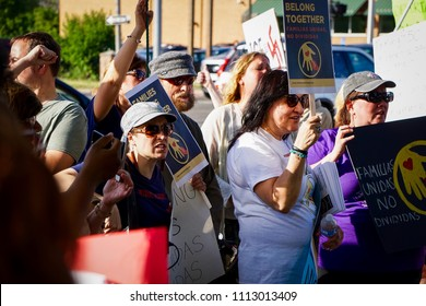 DETROIT, MICHIGAN - JUNE 14, 2018: Activists listen to speakers at the protest to Keep Families Together in Detroit.