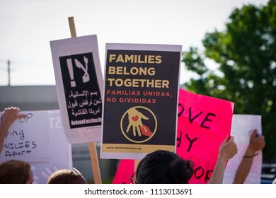 """DETROIT, MICHIGAN - JUNE 14, 2018: Activists hold multi-lingual signs. (Arabic sign translates to: """"No! In the name of humanity, we refuse to accept a fascist United States"""")"""
