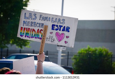 "DETROIT, MICHIGAN - JUNE 14, 2018: A spanish sign translates to, ""Families deserve to be united"" at the protest to Keep Families Together in Detroit."