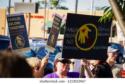"DETROIT, MICHIGAN - JUNE 14, 2018: Protestors display multi-lingual signs at the protest to Keep Families Together in Detroit. (Spanish on sign translates to: ""Families United, not Divided"")"