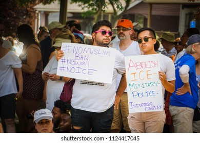 DETROIT, MICHIGAN - JUNE 30, 2018: Two activists in Detroit hold signs to protest ICE.