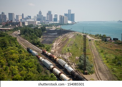 Detroit Michigan Railroad - The railroad and shipping docks along the Detroit River with downtown Detroit, Michigan in the background on a hazy summer day.