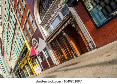 Detroit, Michigan / USA - April 25 2013: Section of colorful, historic buildings and restaurants in downtown Detroit on Woodward Avenue including Coney Island, Bangkok Crossing and Grand Trunk Pub.