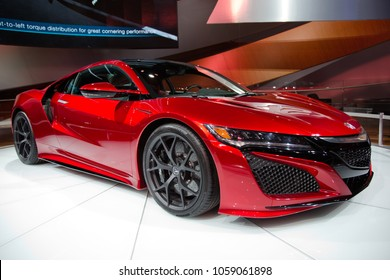 Detroit, Michigan / USA - January 21, 2015:  Isolated red Acura NSX at the North American International Auto Show.