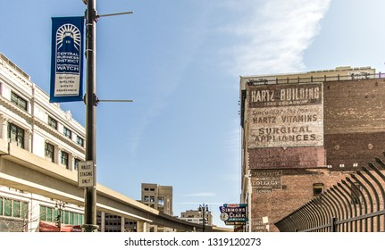 Detroit, Michigan, USA - March 20, 2018: The historic Grand Circus Park neighborhood in downtown Detroit with neighborhood watch sign in the foreground.