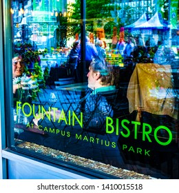 Detroit, Michigan / USA - September 30 2015: A bistro eating place with window and street reflections.